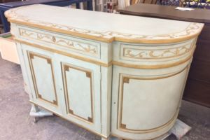 Painted and glazed chest with gold leaf trim
