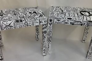 Linen-wrapped end tables, hand painted with graffiti artwork